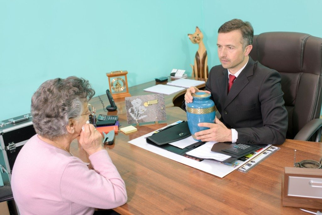 Woman talking to an agent about funeral plans