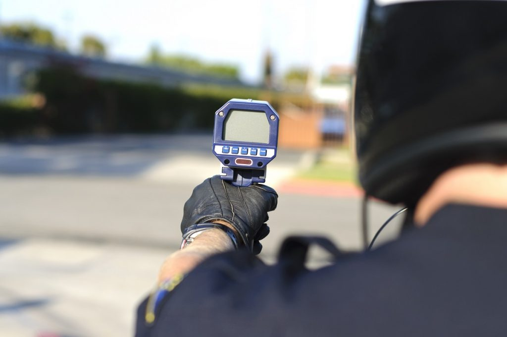 Police man using radar gun