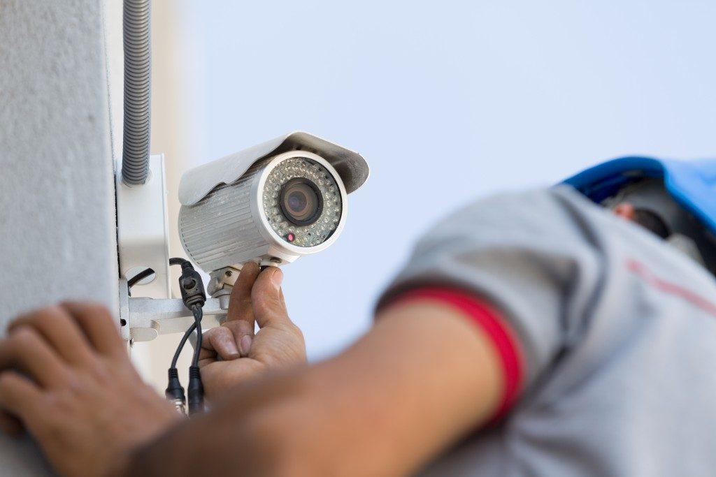 Technician installing cctv