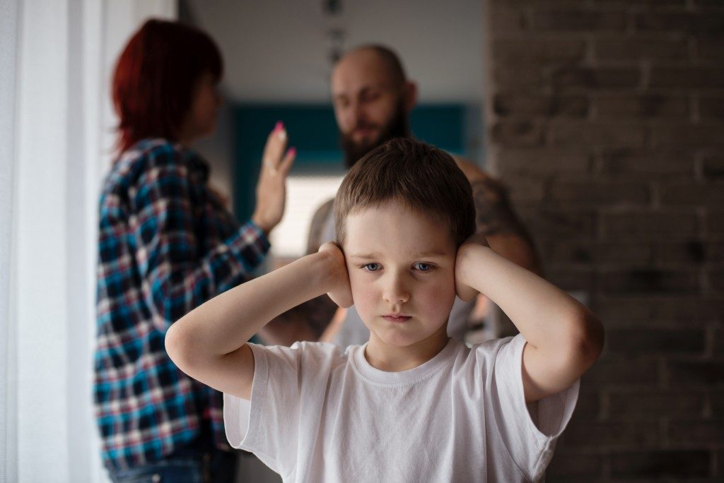 Parents arguing behind child