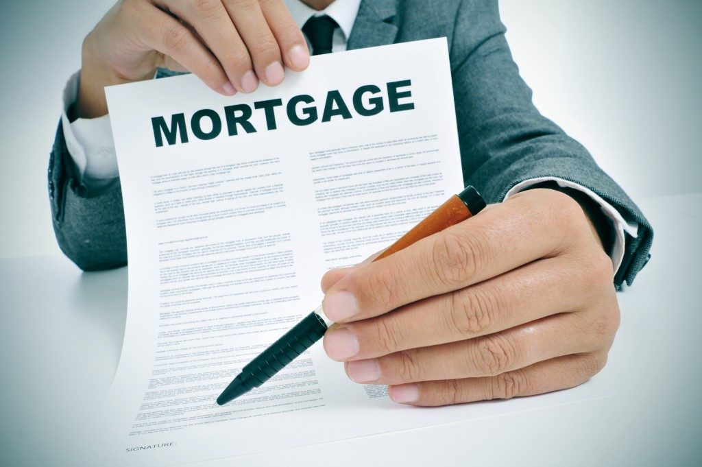 Man showing mortgage loan contract