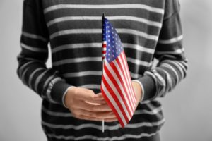 holding a US Flag