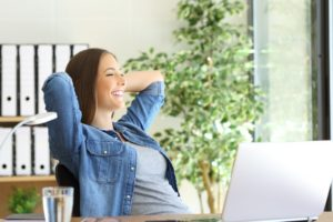 Woman relaxing in her office