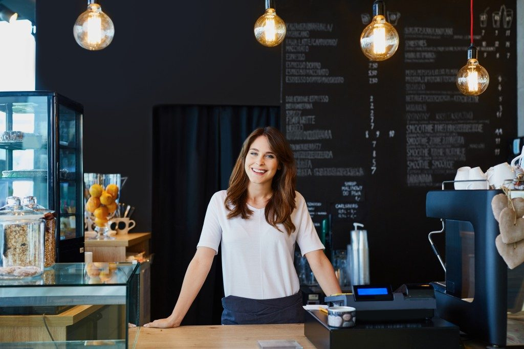 Business owner standing in her cafe