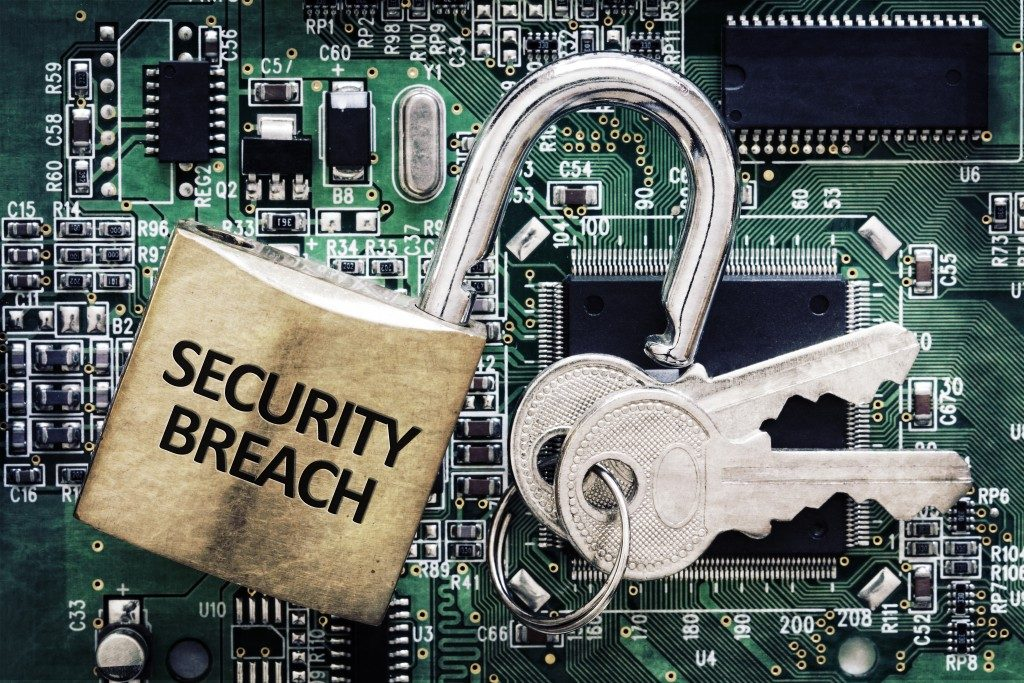 Internet computer security and network protection concept, padlock and key on circuit board