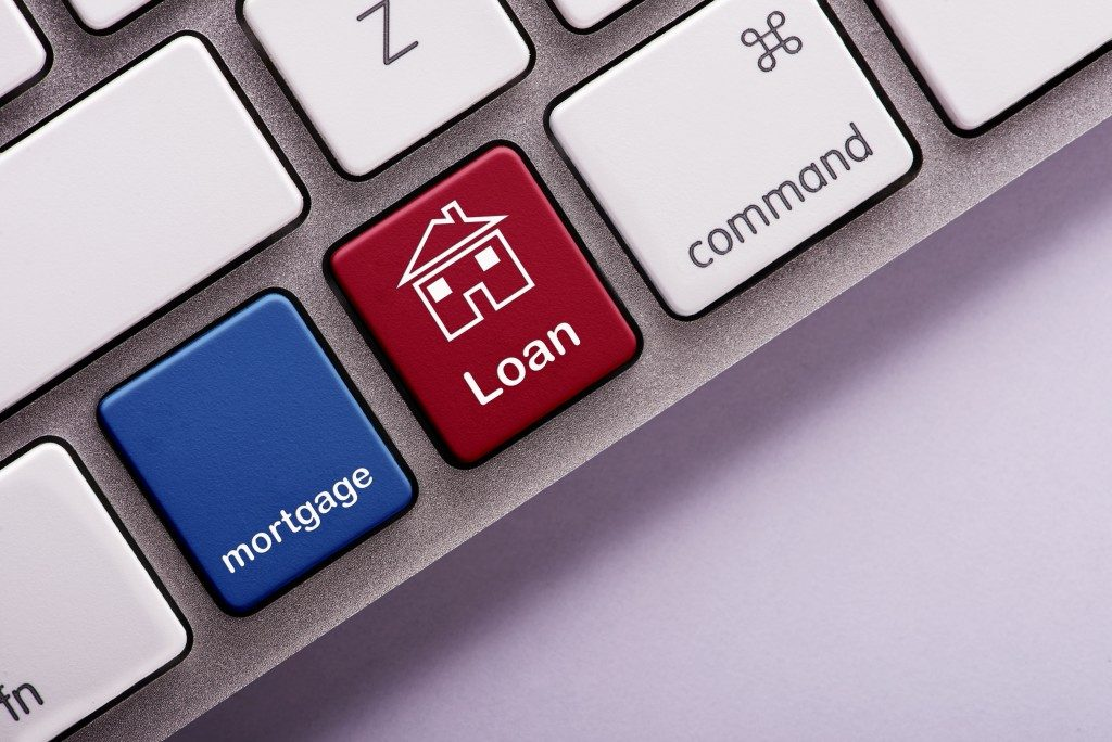 Mortgage loan button on white computer keyboard