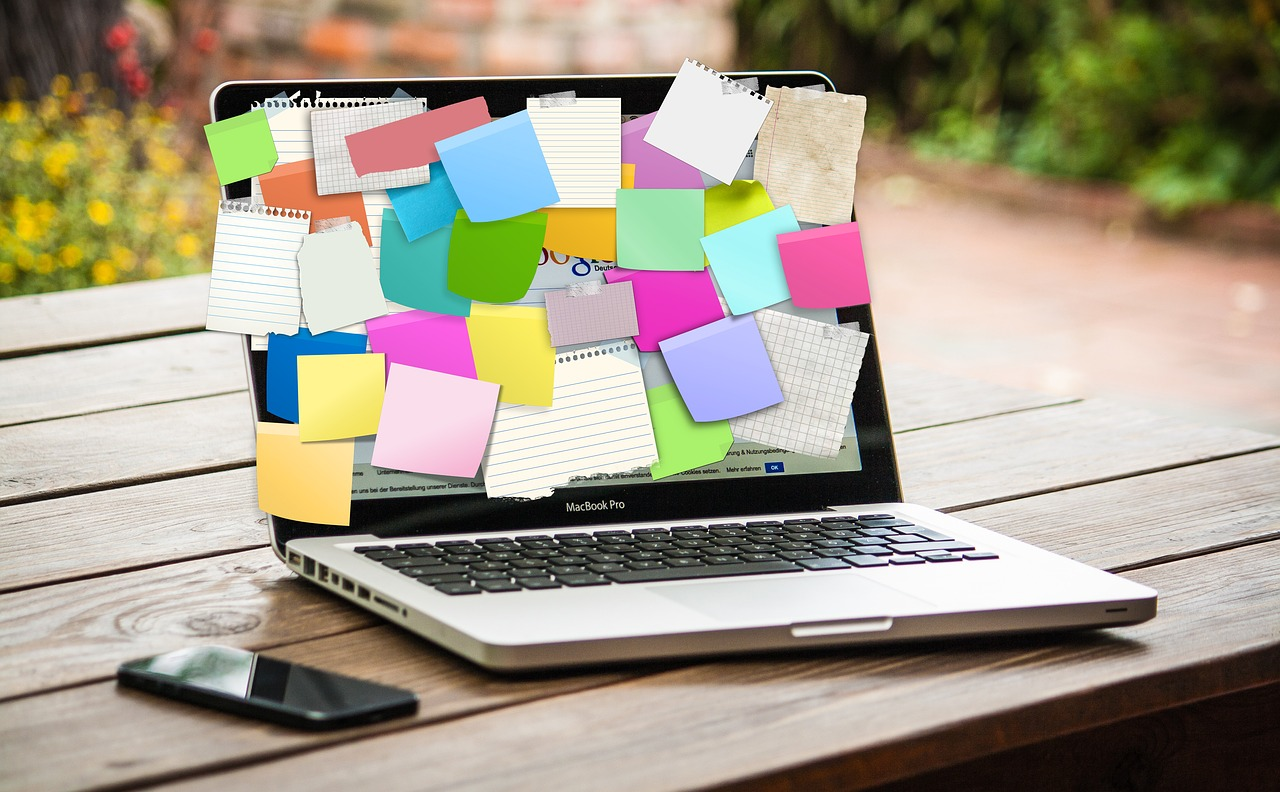 laptop with post it notes