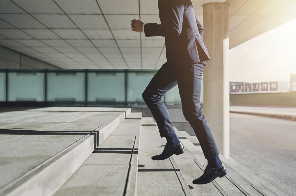 man climbing up stairs
