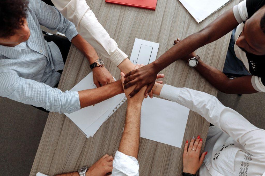 employees huddling together