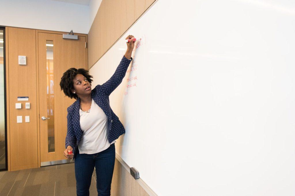 a professor writing