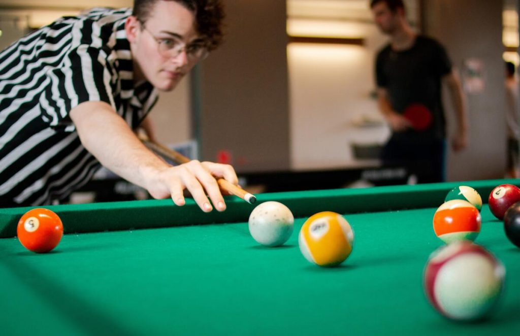playing pool with colleagues