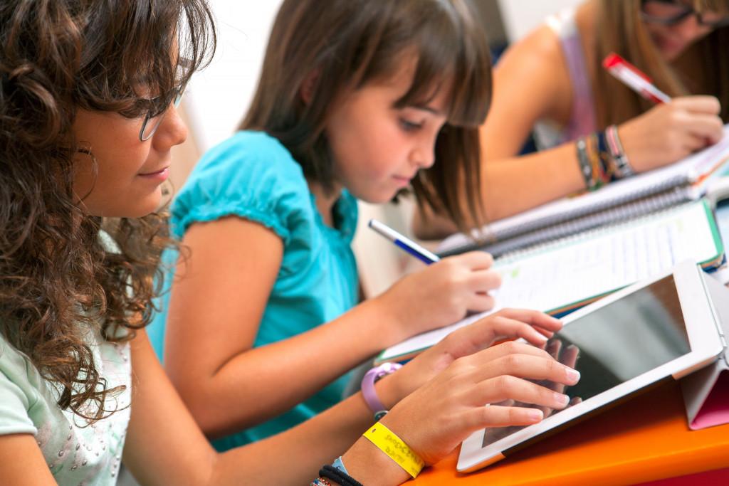 Close up of Teenage girls doing homework.